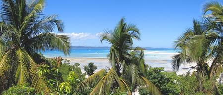 great bay: Sand bank and palm trees - Nosy Iranja - Nosy Be island - Panoramique - Madagascar. Stock Photo