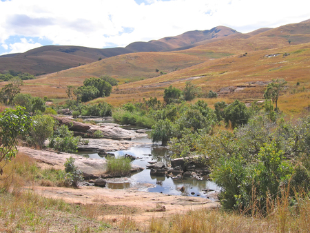 between: Small river between the hills - Andringitra park - Madagascar.