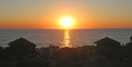 Sunset with bungalows in the desert in front of the sea - Anakao - Madagascar - Panoramique.