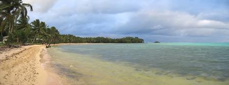 Tropical beach with lush vegetation - Nosy Boraha - Sainte-Marie island - Madagascar - Panoramique. Stock Photo
