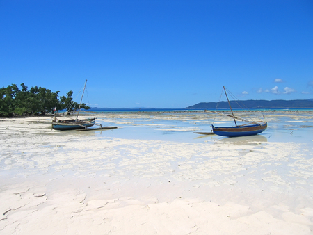 Two fisherman boats standing on the beach - Nosy Iranja - Nosy Be island - Madagascar.