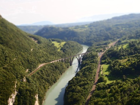 Diorama effect with road and river with bridge and rails - France - Alps. photo