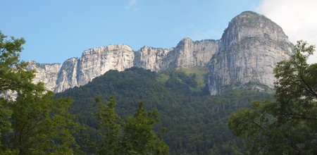 Mountains with white cliffs and forest in the foreground - France - The Alps - Panorama.