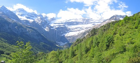 Panoramic view of the Gavarnie Circus mountains with forest in the foreground - The Pyrenees - France - Panorama. Stock Photo