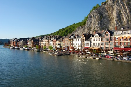 The village and the river with tourist going to restaurant - Dinant city - Belgium - Wallonia. photo