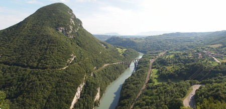 View of the swiss mountains and river with bridge from the french Fort of the Ecluse - France - The Alps - Panorama. photo