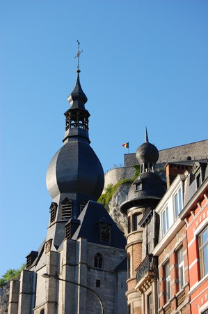 Detail of a old architecture church tower and castle behind - Dinand city - Belgium - Wallonia. Stock Photo