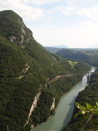 Vertical view of the swiss mountains and river with bridge from the french Fort of the Ecluse - France - The Alps.
