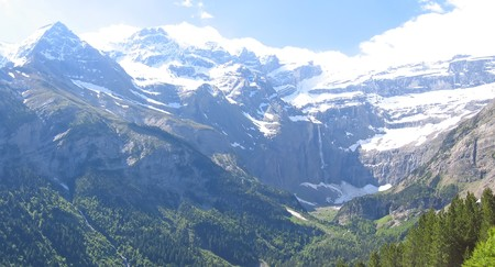View of the Gavarnie Circus mountains with forest in the foreground - The Pyrenees - France. Stock Photo