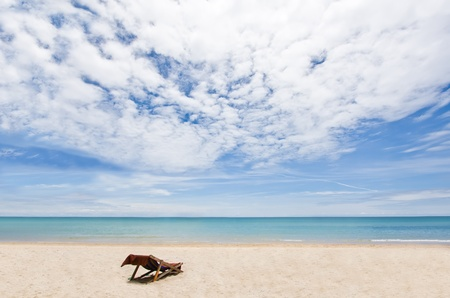 Beach chair on white sand overlooking Andaman