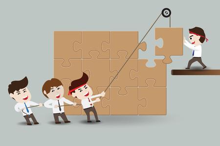 team concept: Teamwork, business men assembling pieces of a puzzle
