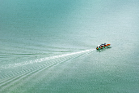 Lonely long tail boats at the sea, Thailand