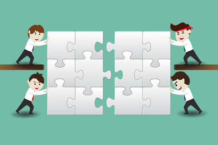 Teamwork, business men assembling pieces of a puzzle