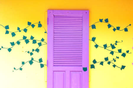 Yellow, purple door on the wall