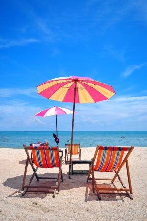 chair under umbella on the beach thailand photo