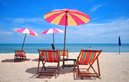chair under umbella on the beach thailand Stock Photo