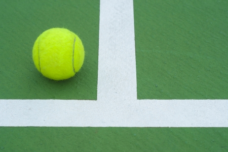 tennis  ball on line court Stock Photo