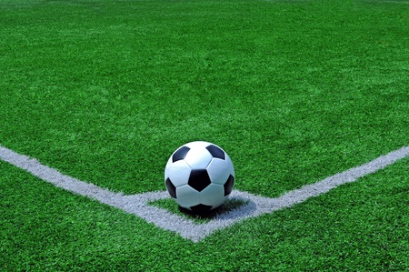 football, soccer ball on pitch photo
