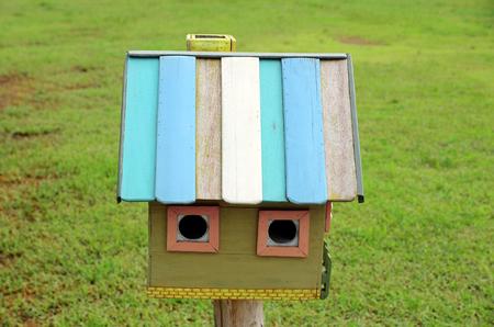 bird house on green photo