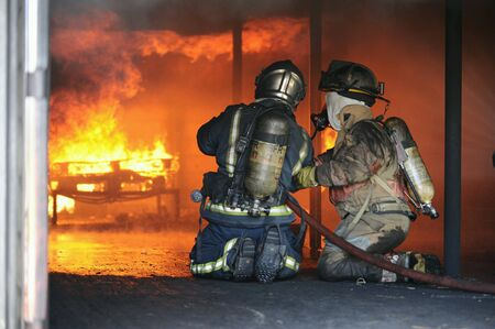 Fire fighting training. Stock Photo