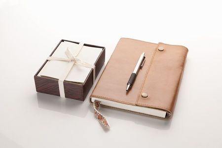 personal record: Leather Journal notebook with a box of cards and a pen Stock Photo