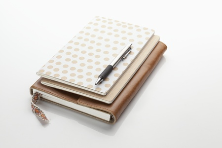 paper and leather bound notebooks photo