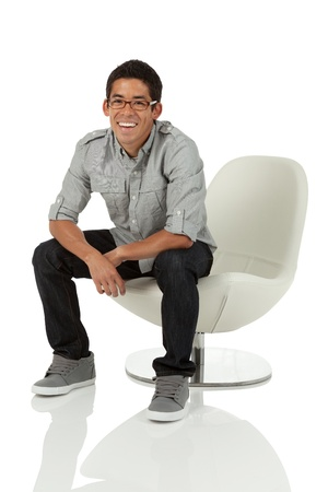 Man sitting on a moder chair photo