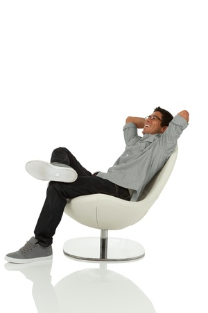 Man sitting on chair relaxing looking up photo