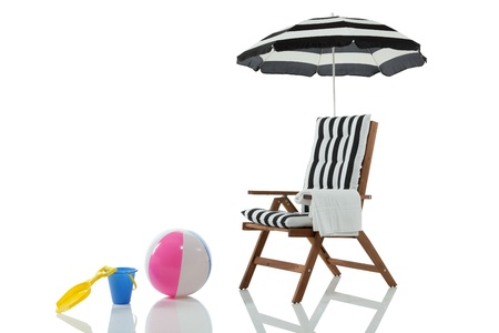 folding chair: Beach chair with umbrella and beach toys isolated on white