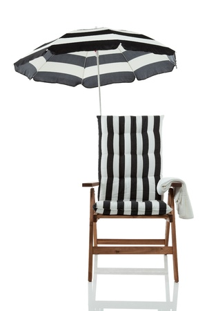 folding chair: Beach chair with umbrella and towel front view isolated on white