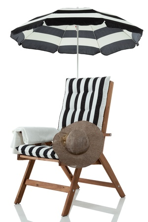 beach umbrella: Beach chair with umbrella, towel and sunhat isolated on white Stock Photo