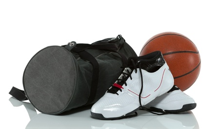 Gym bag, basketball and shoes isolated on white photo