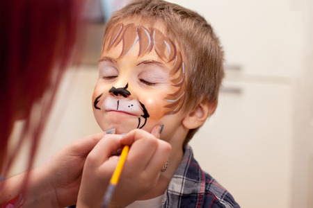 painted face: Little boy with painted face as a lion  Stock Photo