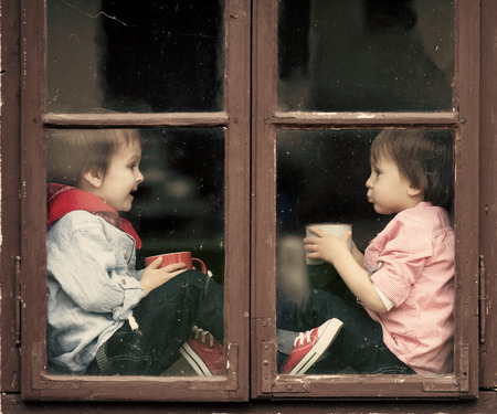 day dream: Two boys on the window, laughing and drinking tea, having fun