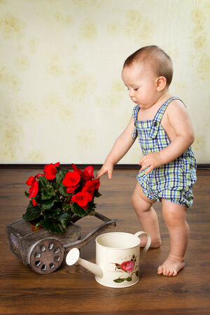 watering pot: Boy with a watering pot