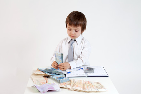 Young man, counting money and taking notes photo