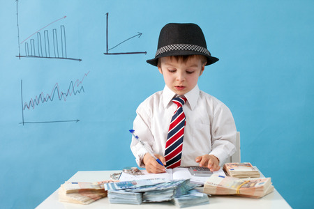 financial official: Young boy, counting money and taking notes