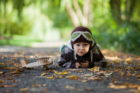 imagines: Boy imagines discovery adventure with a plane in the park