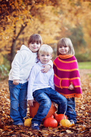 Four adorable kids in the park, playing and having fun photo