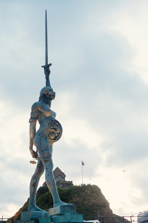 View of Damien Hirsts Verity at Ilfracombe harbour in Devon