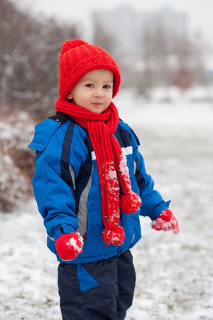 Little boy, playing in the snow photo