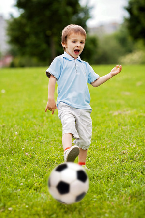 Cute little boy, playing football photo