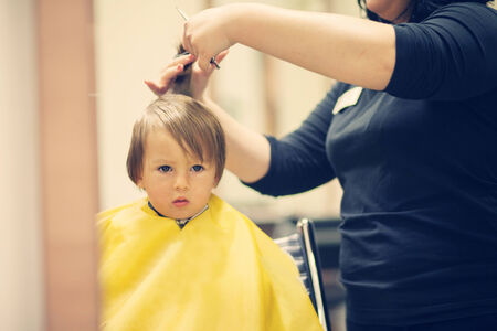 Boy, having haircut  photo