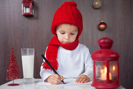 Adorable little boy, writing letter to Santa