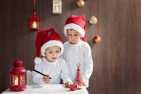 Two adorable boys, writing letter to Santa