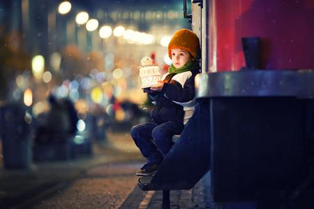 Cute boy, holding lantern outdoor, wintertime