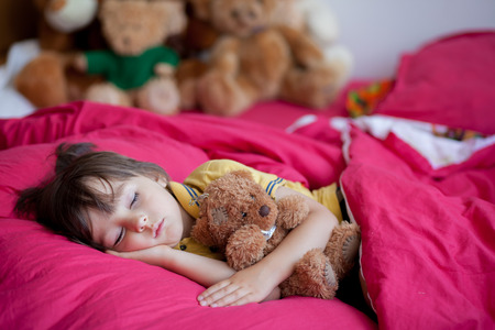 cute teddy bear: Sweet little boy, sleeping in the afternoon with his teddy bear toy Stock Photo