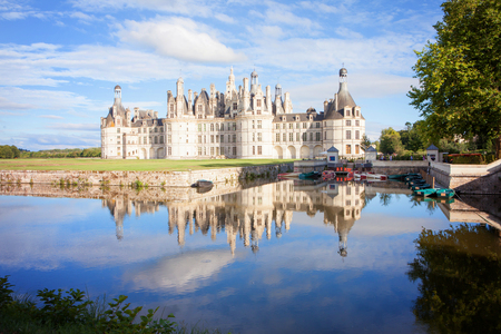 chambord: Chateau de Chambord, royal medieval french castle with reflection in the water canal in front of it at Loire Valley, France, Europe
