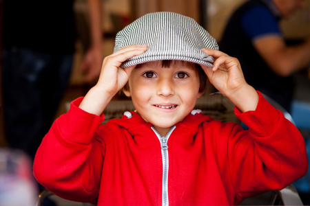 flat cap: Close portrait of Handsome Young Boy with flat cap, outdoors