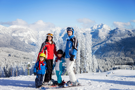 SKI: Group of young beautiful people, adults and kids, skiing in Alps, winter time